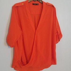 Orange blouse.